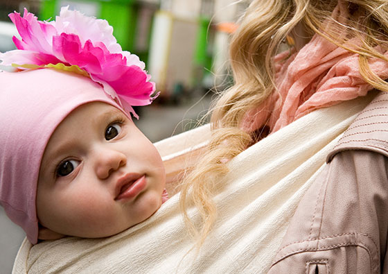 bigstock-Beautiful-Baby-Girl-Carried-By-64232893